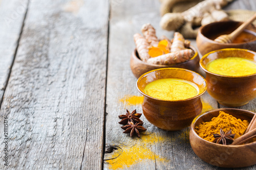 Traditional indian drink turmeric curcuma golden milk with ingredients Canvas Print