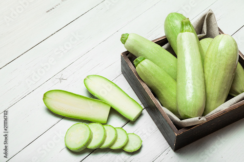 Bright green zucchini, agriculture squash. Courgette close up.