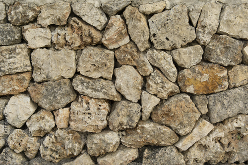 In de dag Stenen Old wall texture background, Majorcan traditional masonry plastered with lime