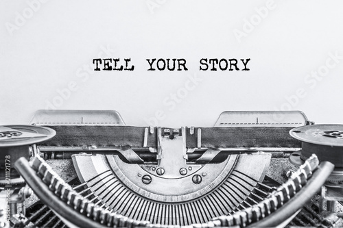 TELL YOUR STORY text typed on a vintage typewriter, old paper, Close-up. history
