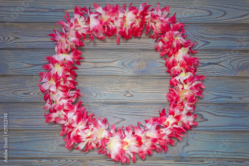 Deurstickers Zuid-Amerika land Hawaiian garland of flowers, wreath on a wooden background.
