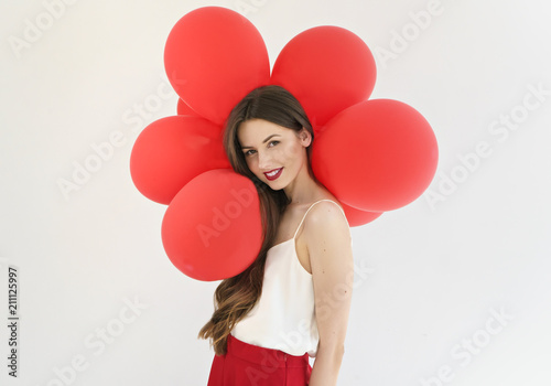 attractive young woman with red balloons on white background фототапет