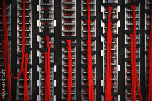 Close up of red wires on the back of the British military's Bombe machine, used Poster