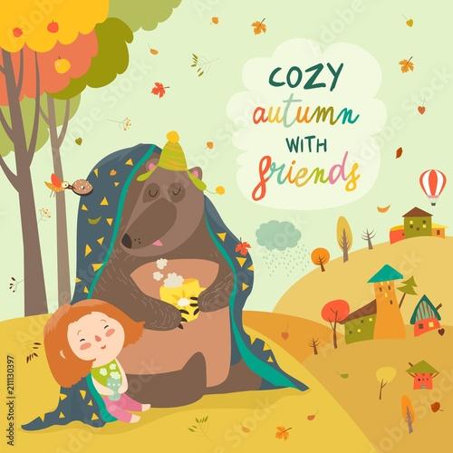 Mała dziewczynka i niedźwiedź siedzi pod szkocką kratą na jesień gazonie