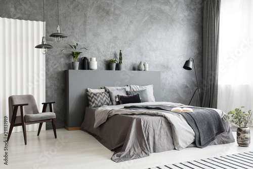 Modern grey bedroom interior with big bed with pillows and linen ...