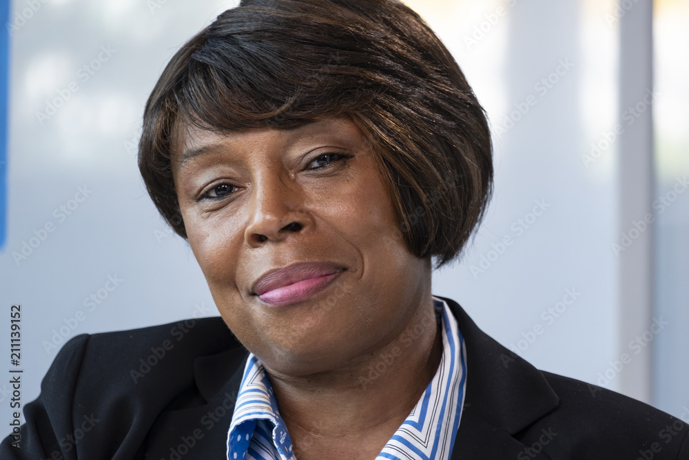 Fototapeta Portrait  of a black woman in business suit, close up