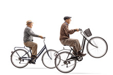 Seniors Riding Bicycles With One Of Them Doing A Wheelie
