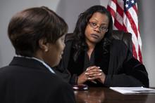 A Judge Deliberating A Court C...