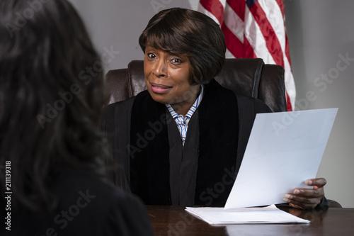 A judge presiding over a case in courtroom Canvas Print