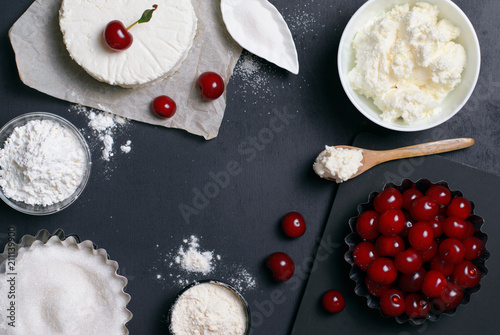 Staande foto Zuivelproducten Dairy Products, Flour, Sugar and Cherries on Black Background