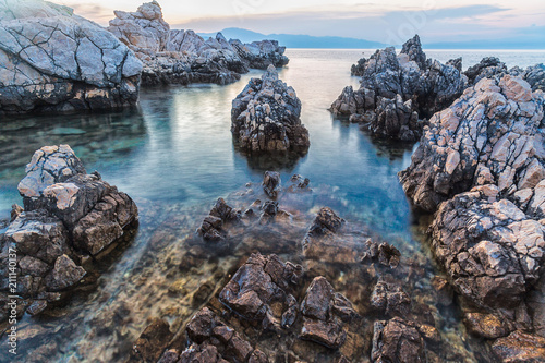 Photographie  Long exposure of sea rocks during sunset