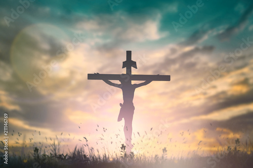 Fototapeta Silhouette of Jesus with Cross over rainbow sunset concept for religion, worship