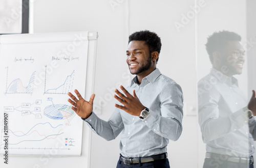 Fotografia  business, education and people concept - african american businessman with flip