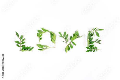 Fototapety, obrazy: Word Love made from leaves on a white background. Valentine's Day concept. Flat lay, top view.