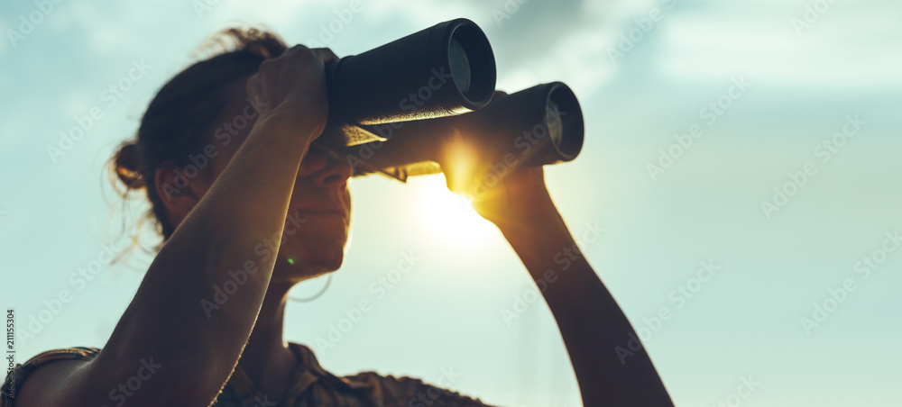 Fototapety, obrazy: Beautiful Young Woman Looking Through Binoculars At The Sea On A Bright Sunny Day