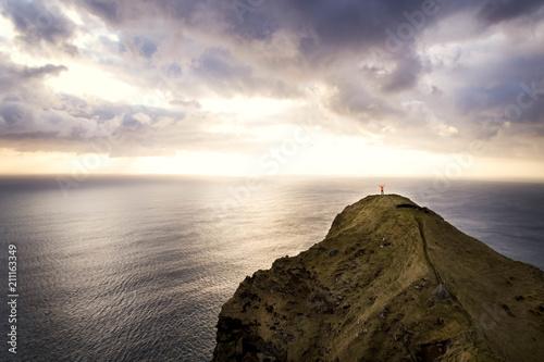 Tuinposter Zee zonsondergang Scenery of sea cliff at sunset, Faroe Islands