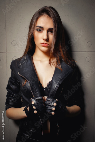 Portrait Of A Beautiful Young Pretty Girl In Black Leather Jacket And Black Bra On A -9526
