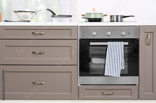 Modern kitchen furniture with electric stove