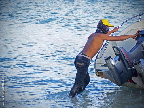 Young terrorist on water transport in asia Fototapeta