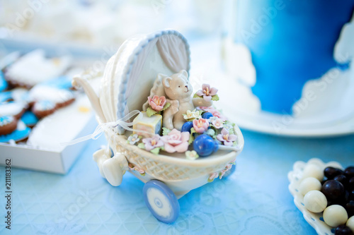 Foto Candy bar decorations on baby's christening party for boy