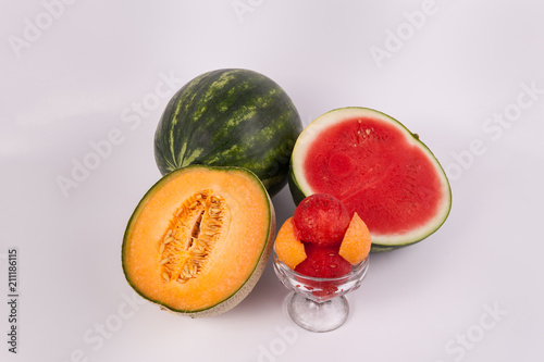 Cantaloupe and watermelon melon fruit cut, scooped in class cup