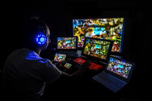 Young Gamer Playing Video Game...