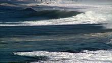 Pan Anticipates Breaking Wave