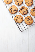 American Cookies With Chocolate Chips On The Grate Fof Oven On White Wooden Background. Top View With Place For Text.