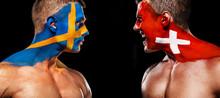 Soccer Or Football Fan With Bodyart On Face - Flag Of Sverige Vs Switzerland.