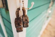 Rusty Open Lock Pads Hanging In A Beach Cabin, Miami Beach