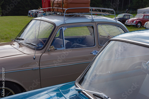 travel case on roof of oldtimer with tricycle © rudolfgeiger