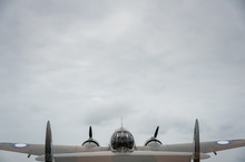 Rear View Of WWII Bomber With Dramatic Sky
