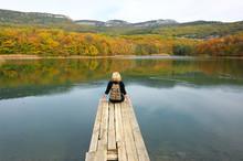 Hiker Woman Sitting Over Lake ...