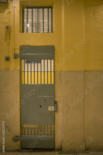 Fotografie, Obraz  vintage iron jail door in prison building with copy space in cinematic tone