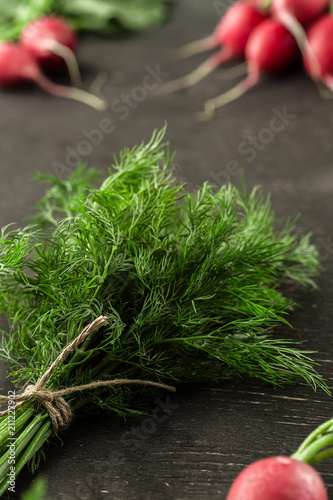 Bunch of fresh dill with radish on wooden table
