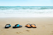 Two Pairs of Lover Sandal on the Beach, Romantic Scence in the Vacation Beach Trip Travel.