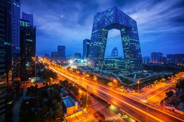 Fototapeta Night cityscape with bilding and road in Beijing city
