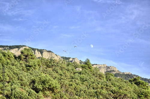 Foto op Aluminium Pistache The Moon in the sky during the day, mountain landscape