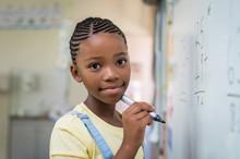 Girl Doing Math At Whiteboard