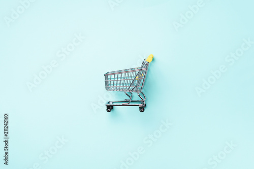 Fotografia Shopping cart on blue background