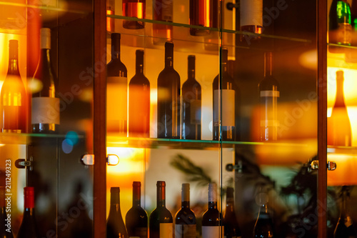 Canvas Prints Bar wine cabinet with glass shelves and door and reflection