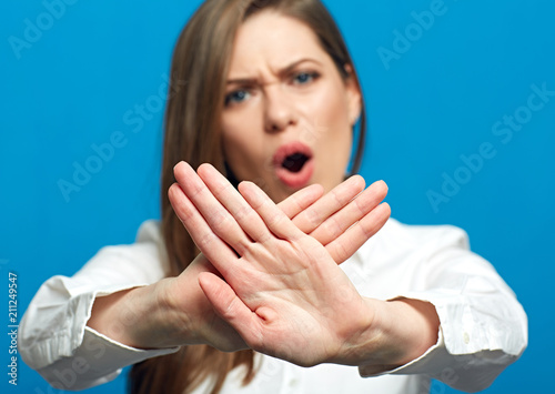 Fotografie, Obraz  Screaming woman showing stop symbol.