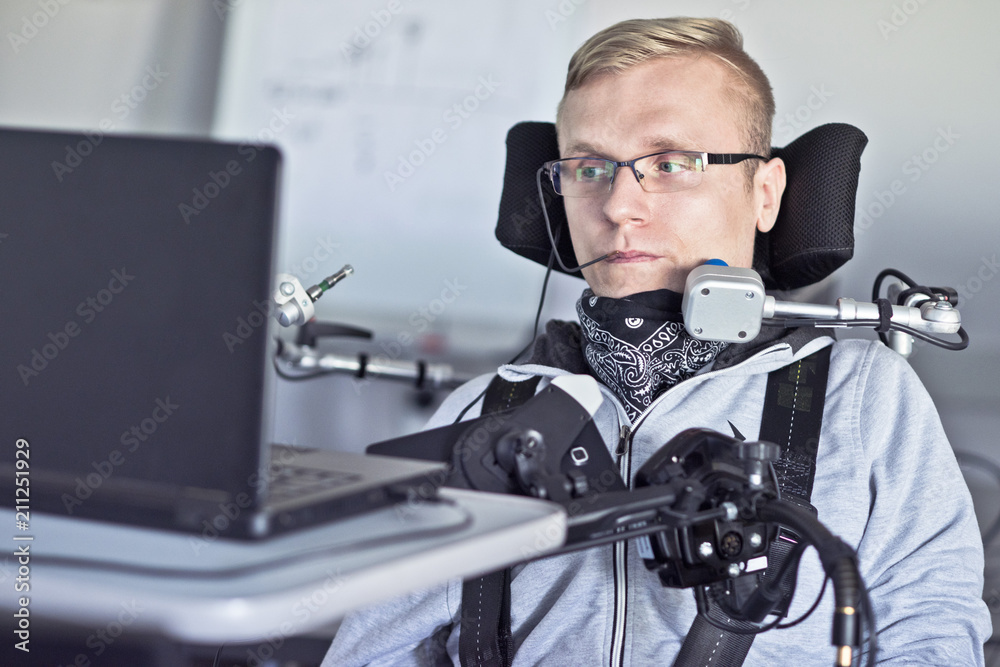 Fototapety, obrazy: Disabled student in class room.