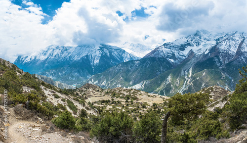 Foto op Plexiglas Blauwe hemel Mountain landscape with trees, bushes and snowy mountains, Nepal.