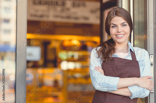 Poster Bakkerij Smiling owner in uniform in the bakery
