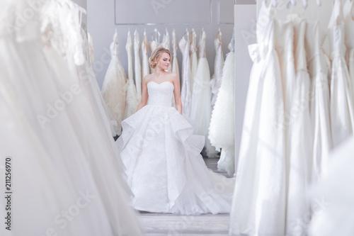 Stampa su Tela Beautiful woman in wedding shop