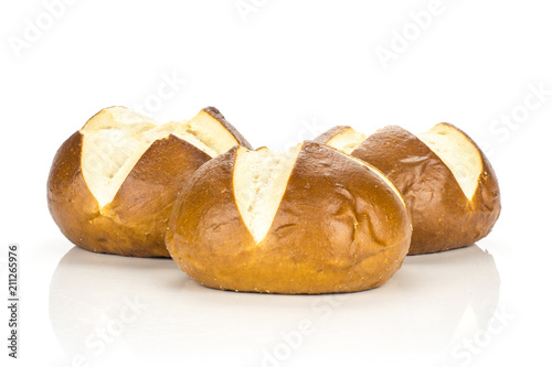 Fotografie, Obraz  Fresh Bavarian bread buns set isolated on white background three baked loaves