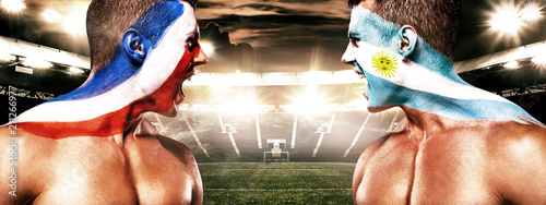 Papiers peints Kiev Soccer or football fan with bodyart on face with agression - flag of France vs Argentina.
