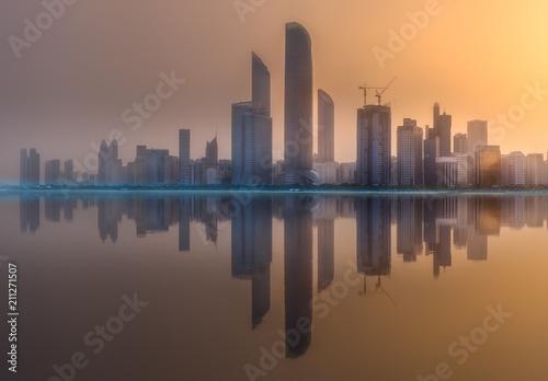 Poster Stad gebouw View of Abu Dhabi Skyline at sunset, UAE