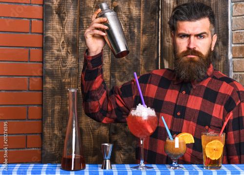 Man in checkered shirt on wooden texture background. Obraz na płótnie